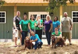 VOLUNTEERS who work at Best Friends Dog Rescue are pictured, kneeling, l-r, Maria Trujillo and Jennifer Rich; standing, Brian McLaughlin, Shalon McLaughlin, Rayne Deese, Laurie Deese, Peggy Blanton, Samantha Contreras and Jerry Hicks.