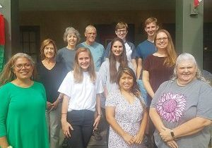 HANDMAIDEN HOUSE VOLUNTEERS include, front row, l-r, Elizabeth Lewis, Marian Sallee, Christina Alicea and Tammy Fincannon; middle row, Marliyn Ricks, Sadie Scott and Brandy Brown; back row, Rhonda Keve, Gary Keve, Clay Brown and Rory Brown. Not pictured is Joy Hickey.