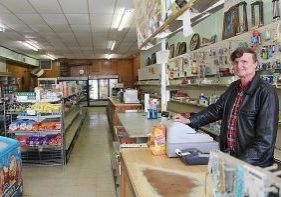 BRUCE THOMAS manned the register at Thomas Mercantile Co. Monday for the last time as the store's owner.