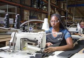 NIVEL SEWING MACHINE OPERATOR Kaysonnia Brown is pictured with Janice Chason, background.