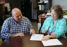 GRADUATION ORGANIZERS Mr. Chris Lokey, C.H.S. principal, and Mrs. Tammy Donalson, assistant principal/instructional coordinator, look over end-of-year plans for the Class of 2021.